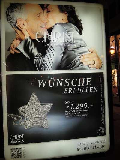 """— Publicité """"Christ"""" dans une artère piétonière de Cologne - Cologne —"""