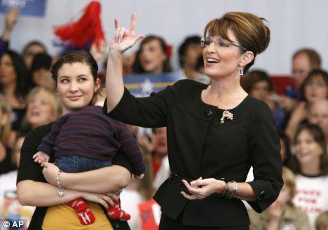 Sarah Palin et son salut cornu
