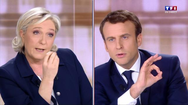 Emmanuel Macron flashant le signe digital 666 face àMarine Le Pen  Capture d'écran TV France2: débat du 4 Mai 2017