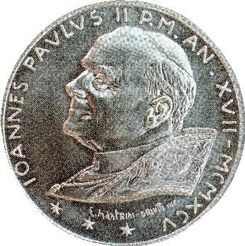 Pièce de monnaie avec ses trois étoiles à six branches présentant l'effigie du pape Jean-Paul II, le Pontifex Maximus Babylonien